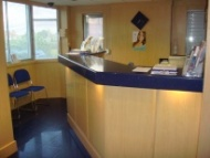 The reception desk located at the entrance to the Scott Arms Dental Practice in Birmingham
