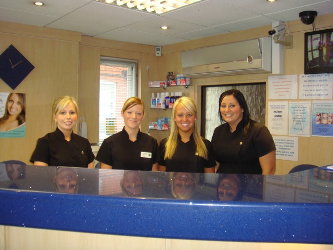 Photo of the reception team that warmly welcomes patients at Birmingham Dentist Scott Arms Dental Practice